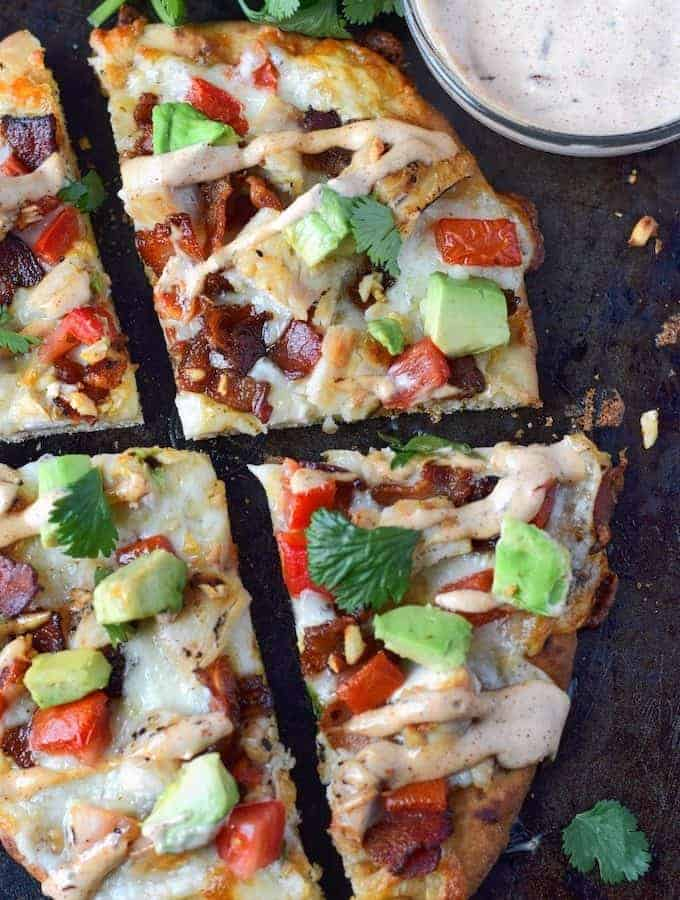 chicken club flatbread cut into slices with a side of chipotle ranch