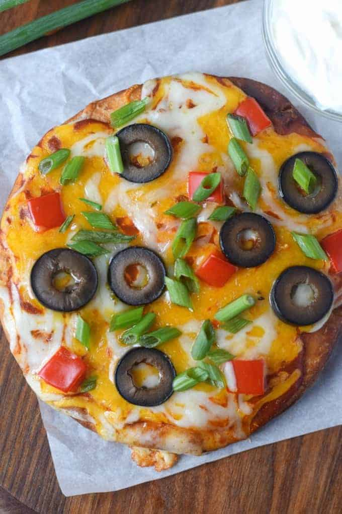 A whole Mexican pizza baked and done before slicing.