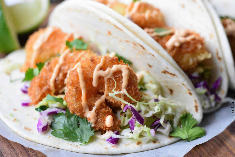 crispy shrimp tacos on a cutting board