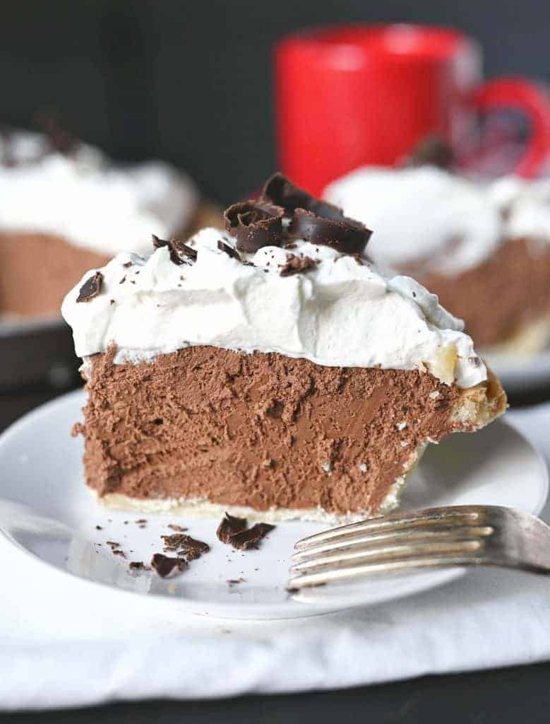 Chocolate cream oie on a white plate with a fork.