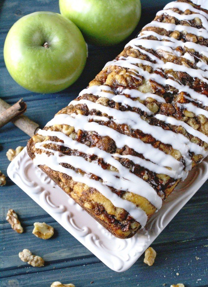 A loaf of apple fritter bread on a white platter.