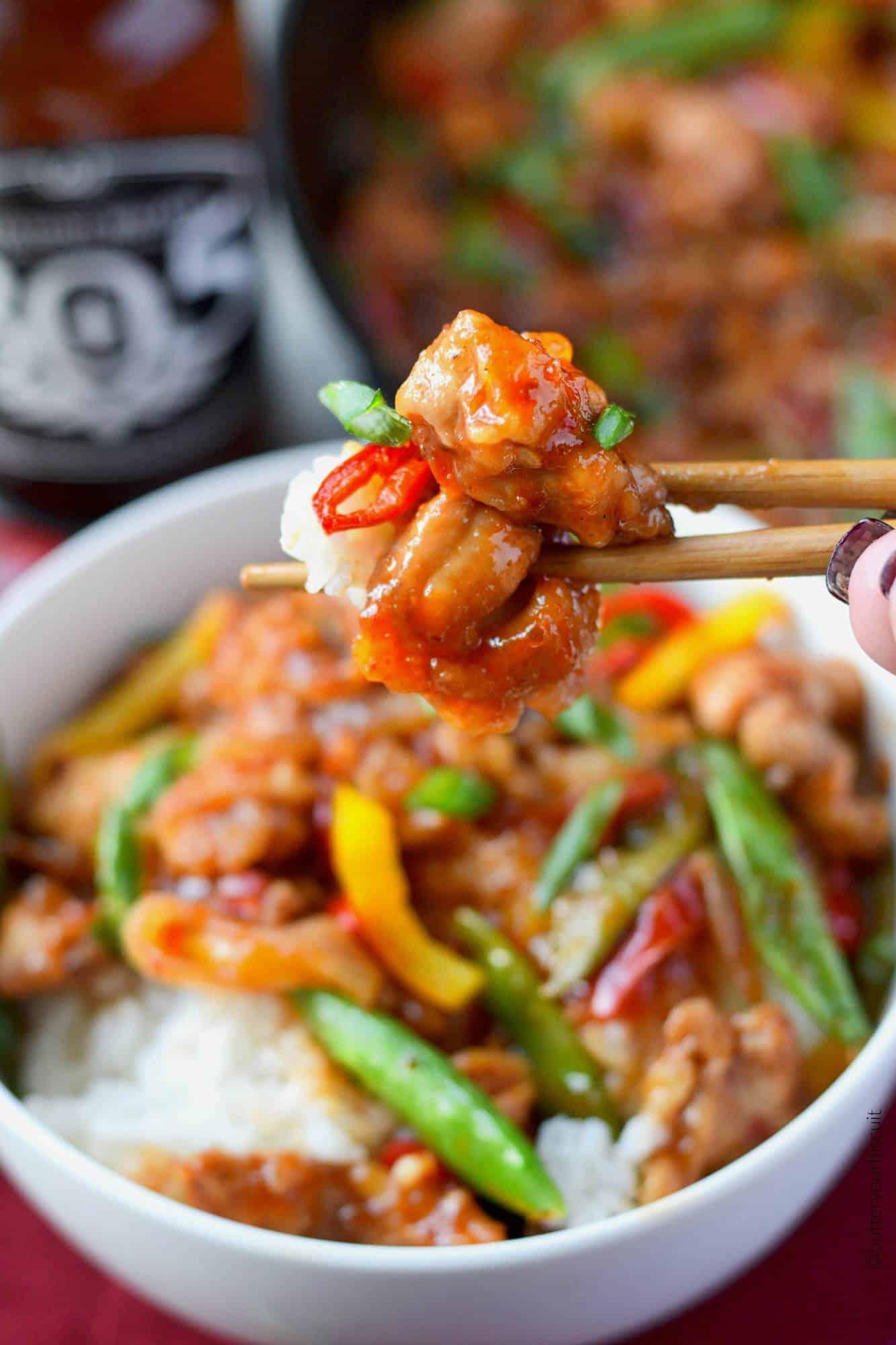 Sweet and Spicy chicken stir fry bite with chopsticks
