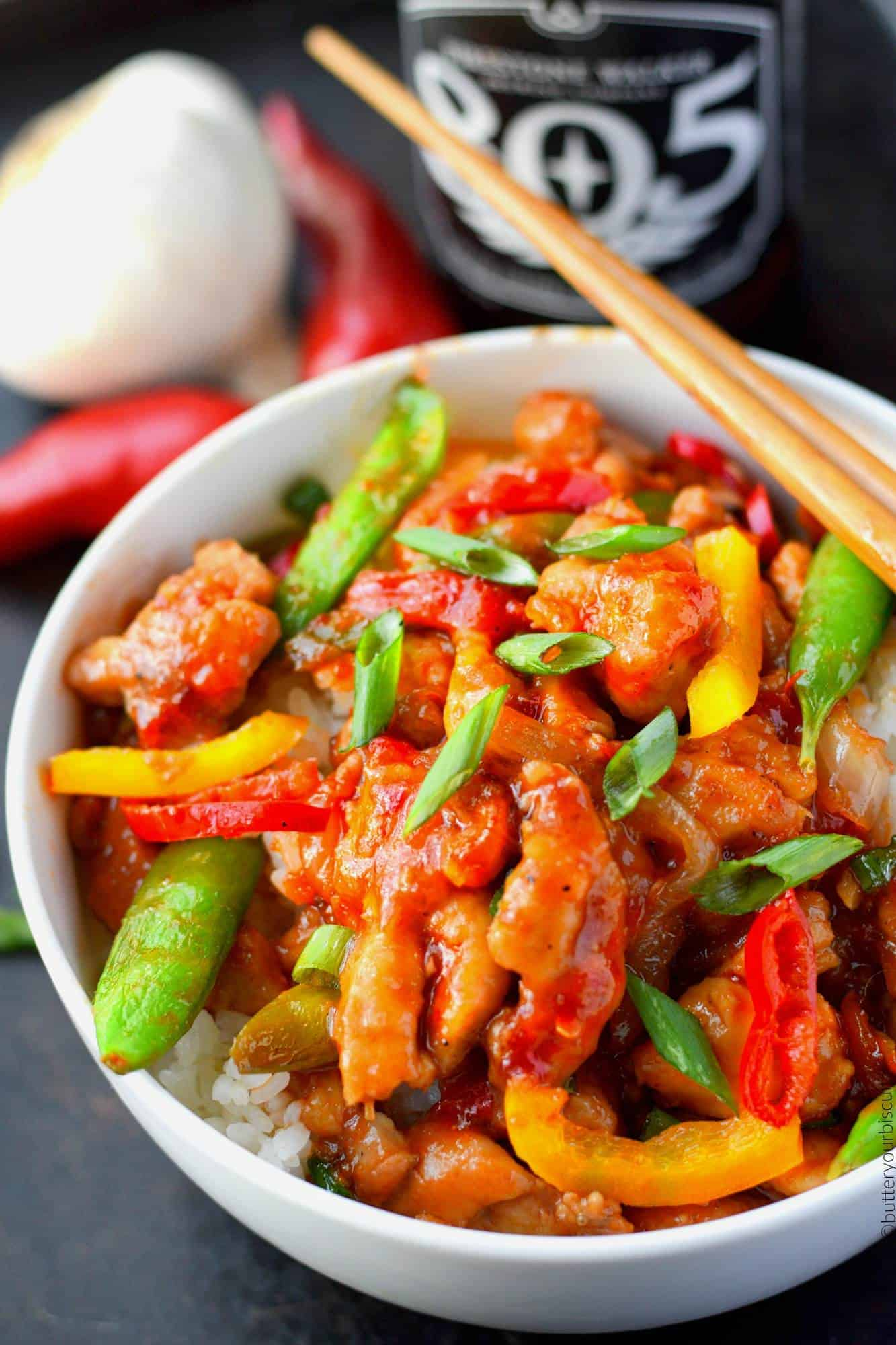 Sweet and Spicy chicken stir fry in a bowl with chopsticks