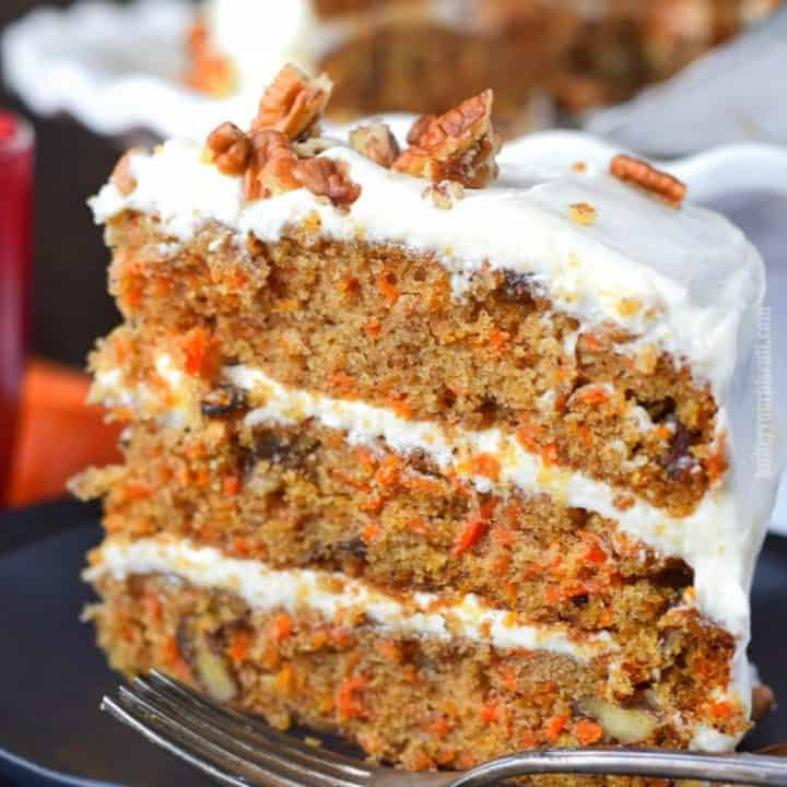 piece of carrot cake with three layers and cream cheese frosting