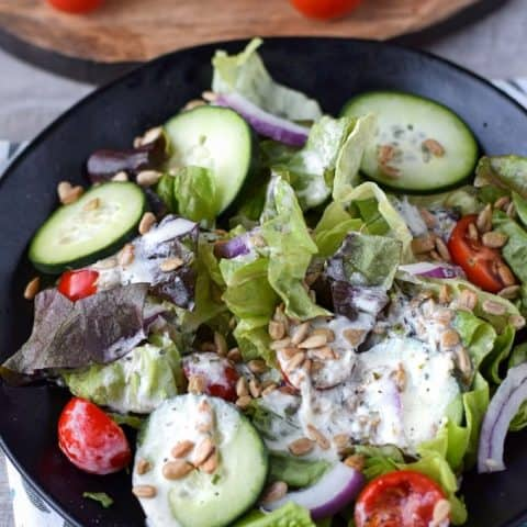 leafy green salad with creamy vinaigrette homemade salad dressing on top