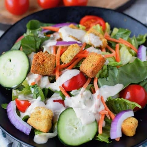 green salad with creamy parmesan homemade salad dressing on top
