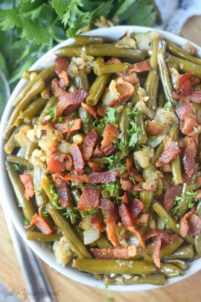 A white bowl full of southern green beans.