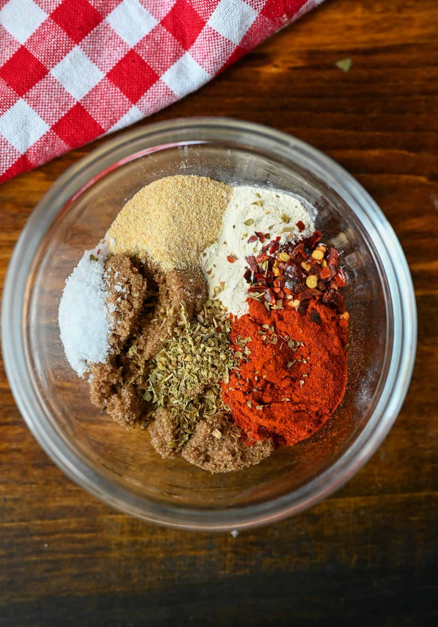 A combination of spices in a small bowl to put on the raw chicken.