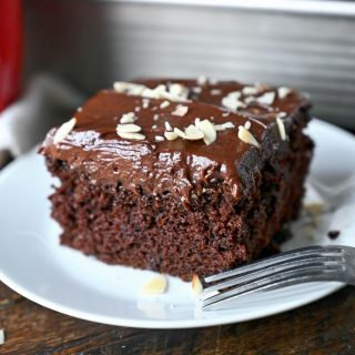 A piece of chocolate mayonnaise cake on a white plate.