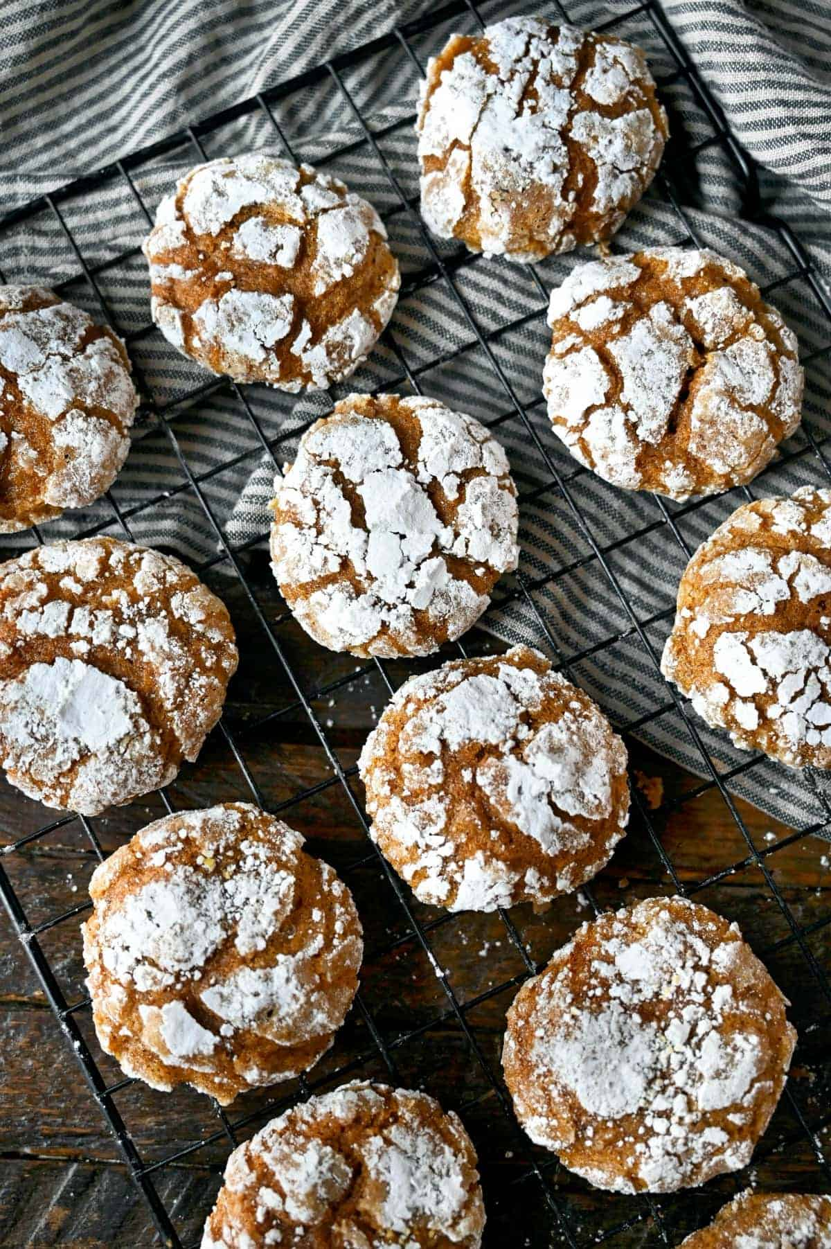 Pumpkin crinkle cookies on a cooling rack.