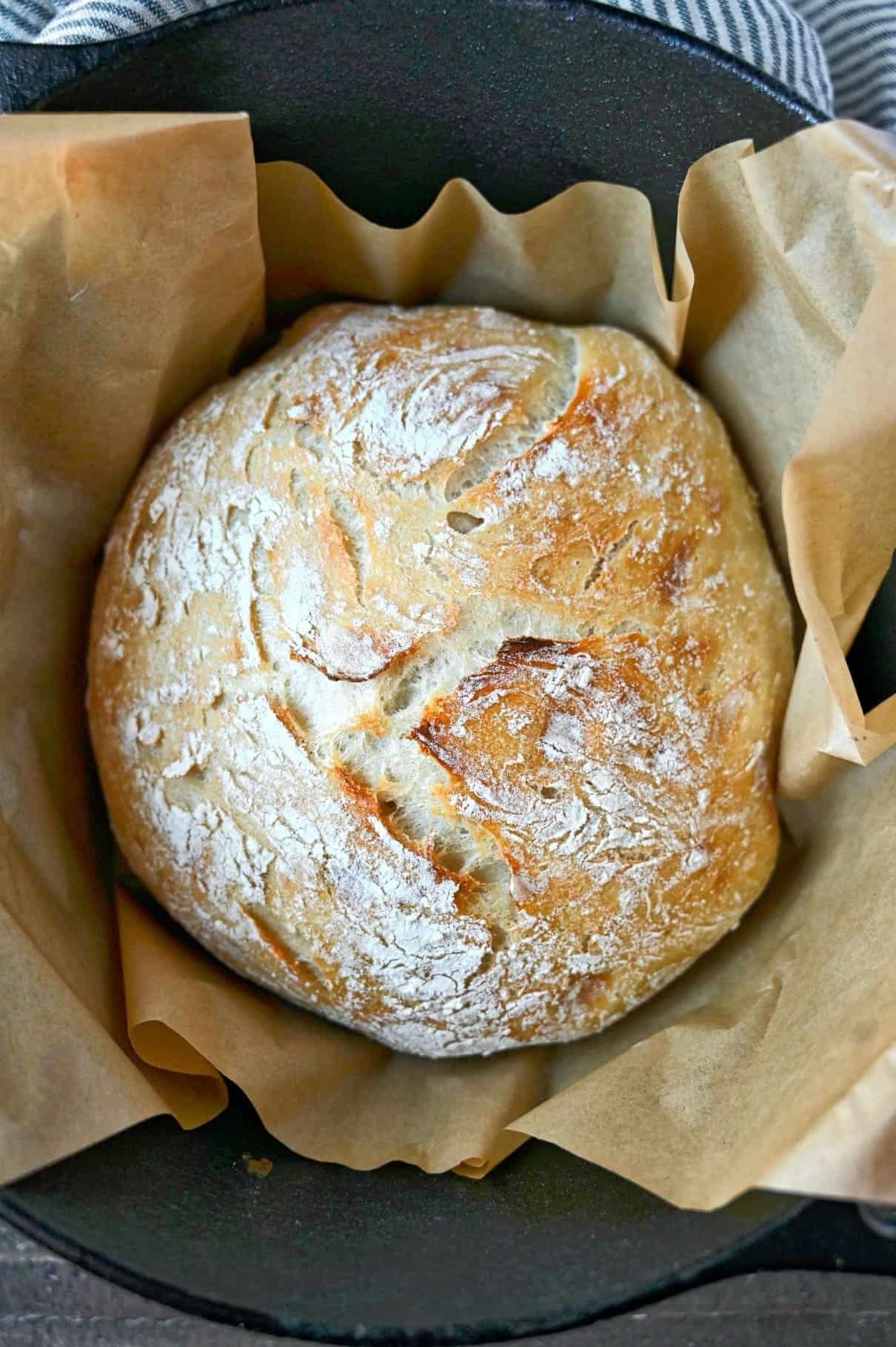 A loaf of artisan bread in a dutch oven.