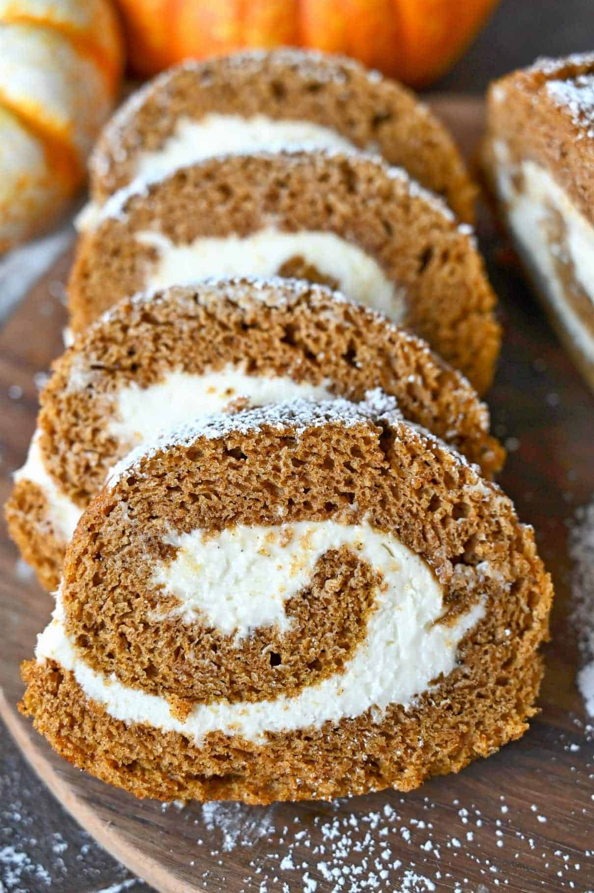 Close up photo of three slices of pumpkin roll cake