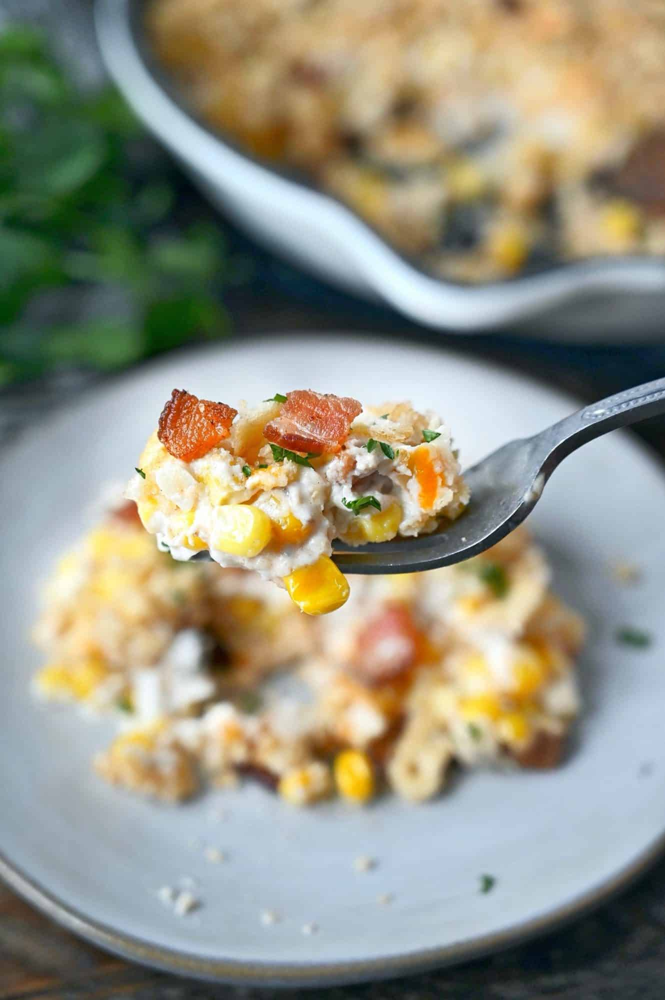 Cheesy creamed corn bite on a fork.