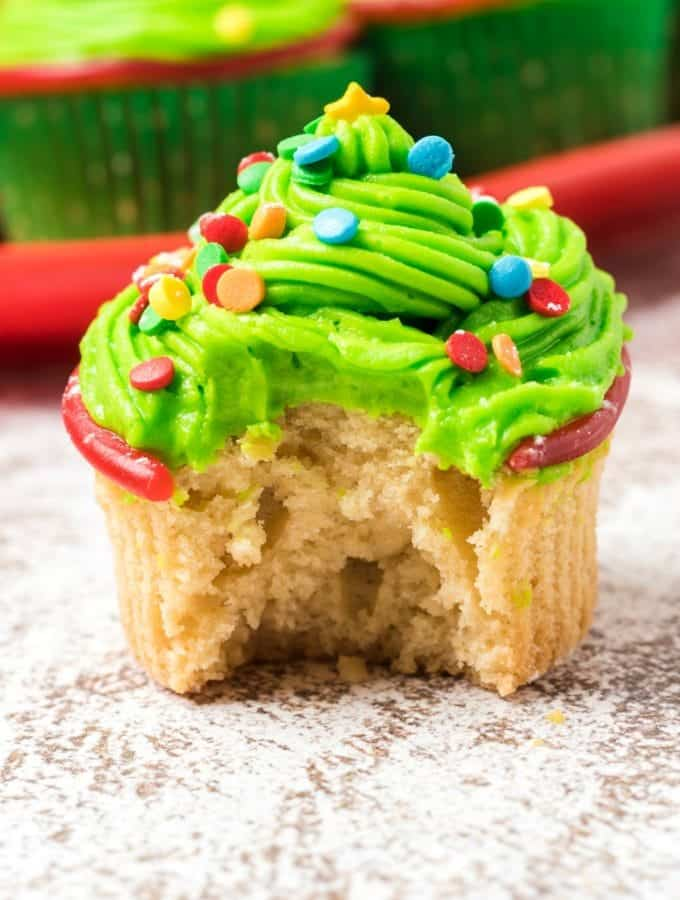 Christmas tree cupcake with a bite out of it.