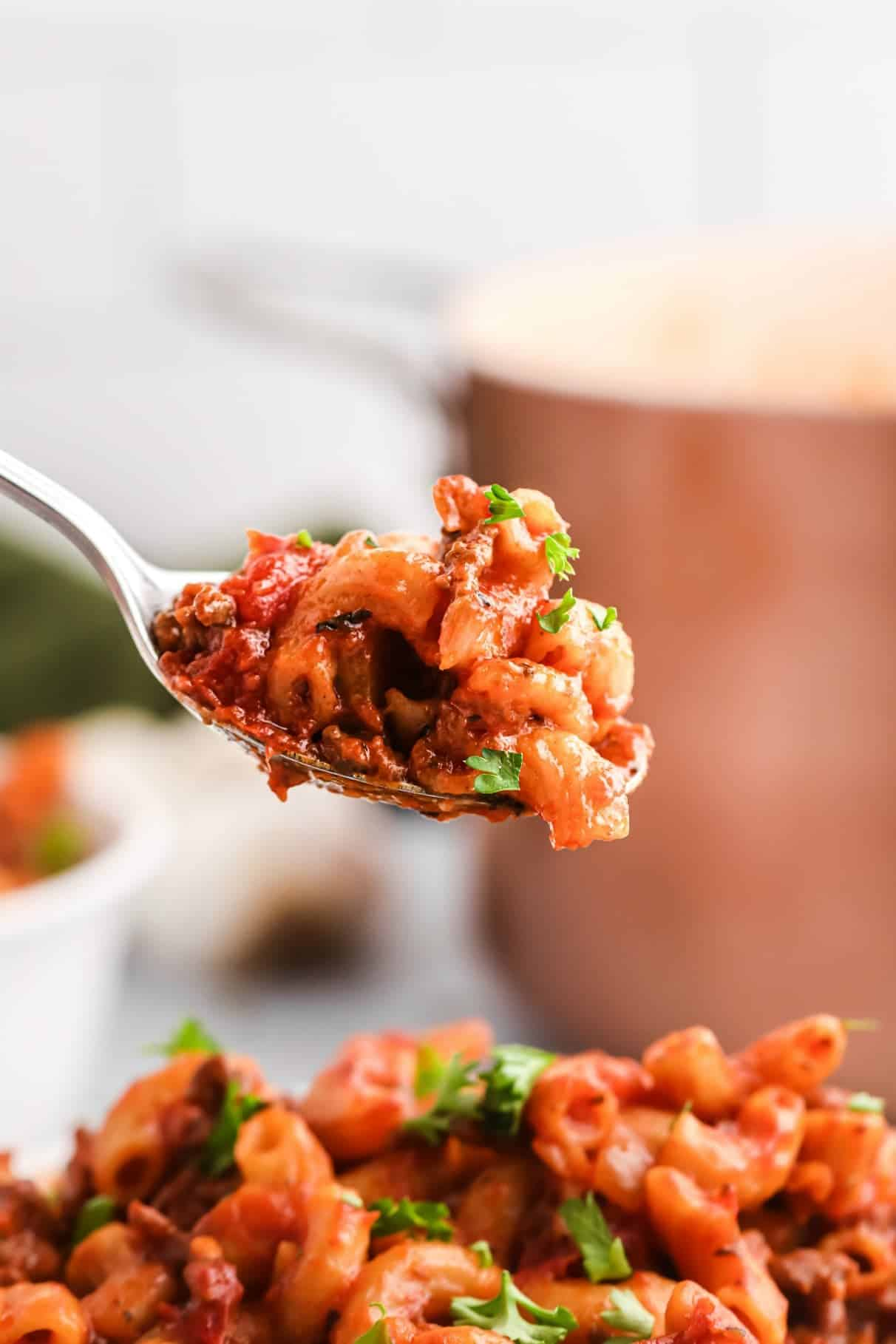 one pot goulash bite on a spoon.