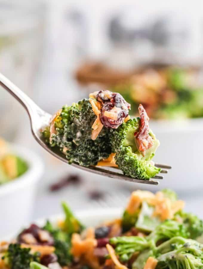 Broccoli salad bite on a fork.