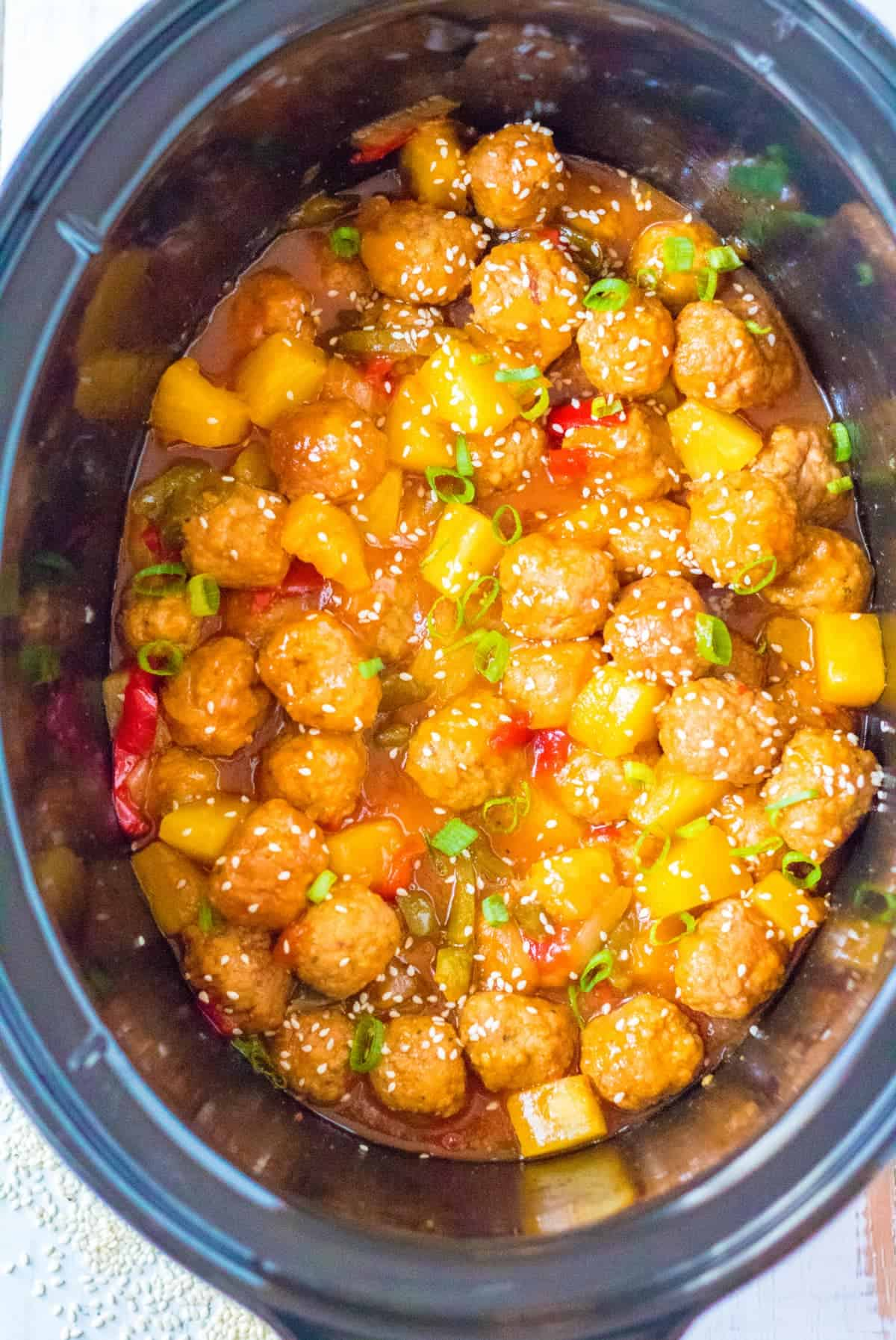 Sweet and sour meatballs that has finished cooking in the slow cooker.