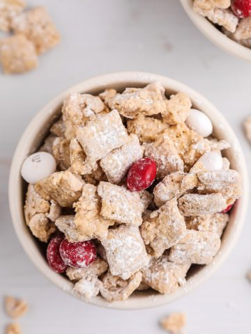 Close up photo of muddy buddies in a white bowl.
