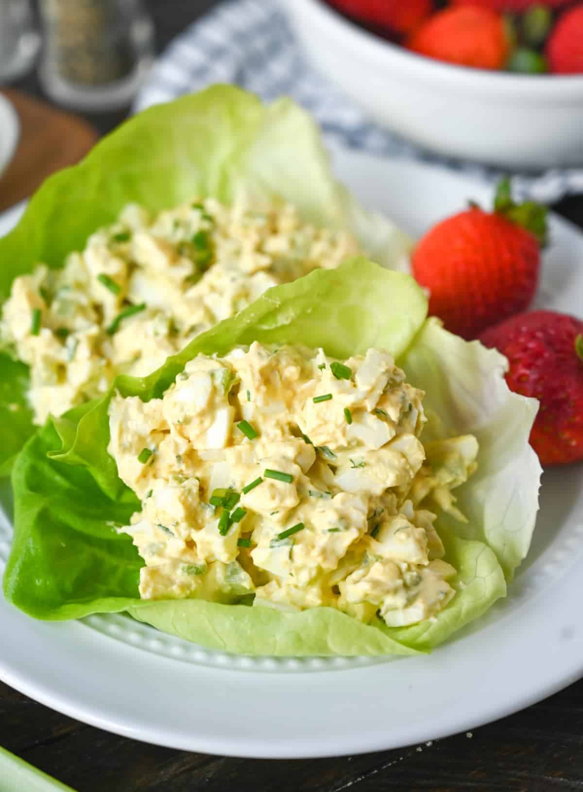 Egg salad place into two lettuce cups.