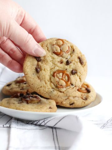 A cookie being held in a hand.