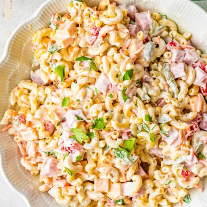 Mexican ham pasta salad all mixed together in a large white bowl.