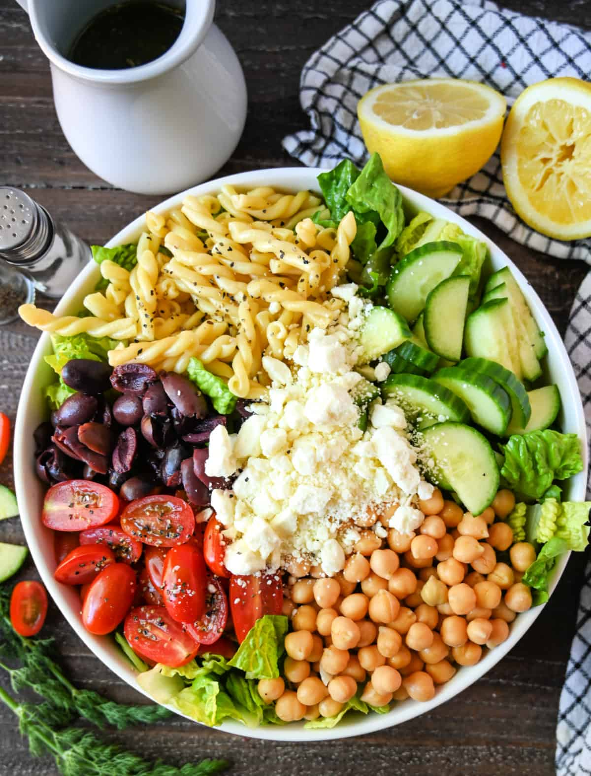 All the ingredients placed into a large white bowl ready to toss.