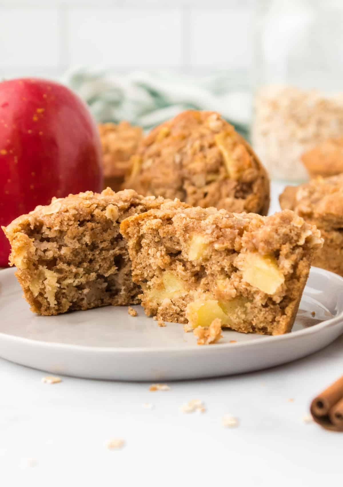 One apple cinnamon muffin cut in half.
