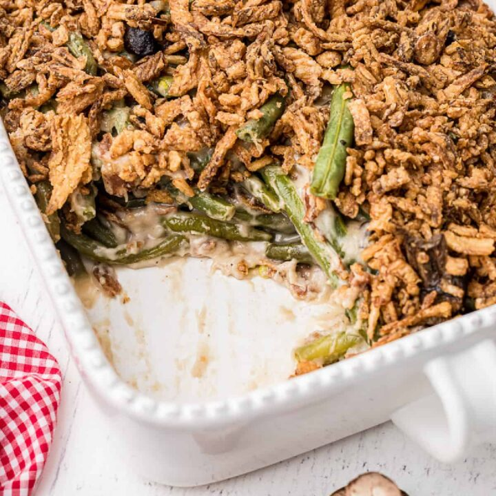 Green bean casserole with a serving missing from the dish.