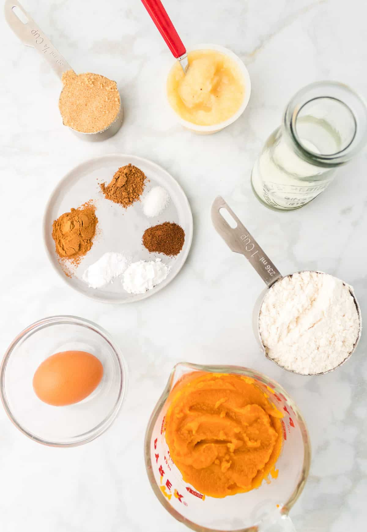 All the ingredients required to make pumpkin muffins.