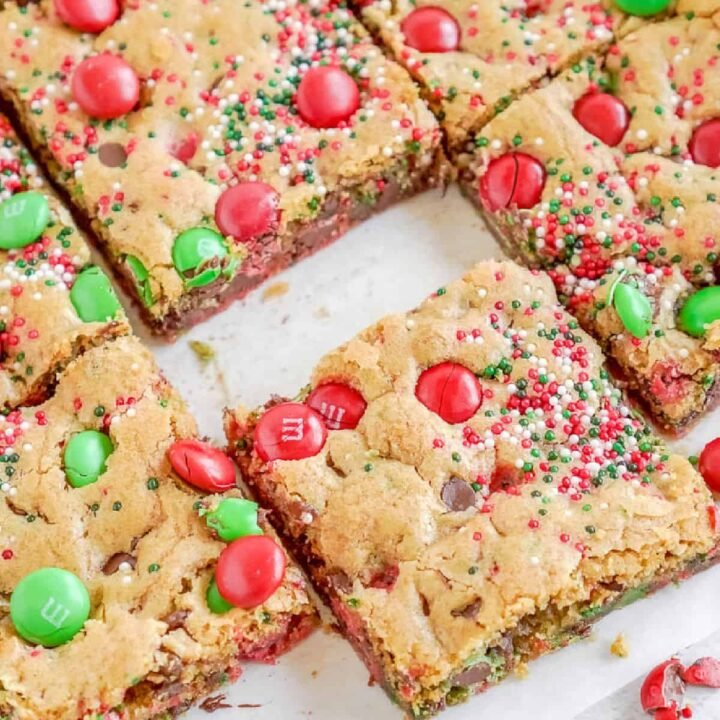 M&M christmas cookie bars cut into squares.
