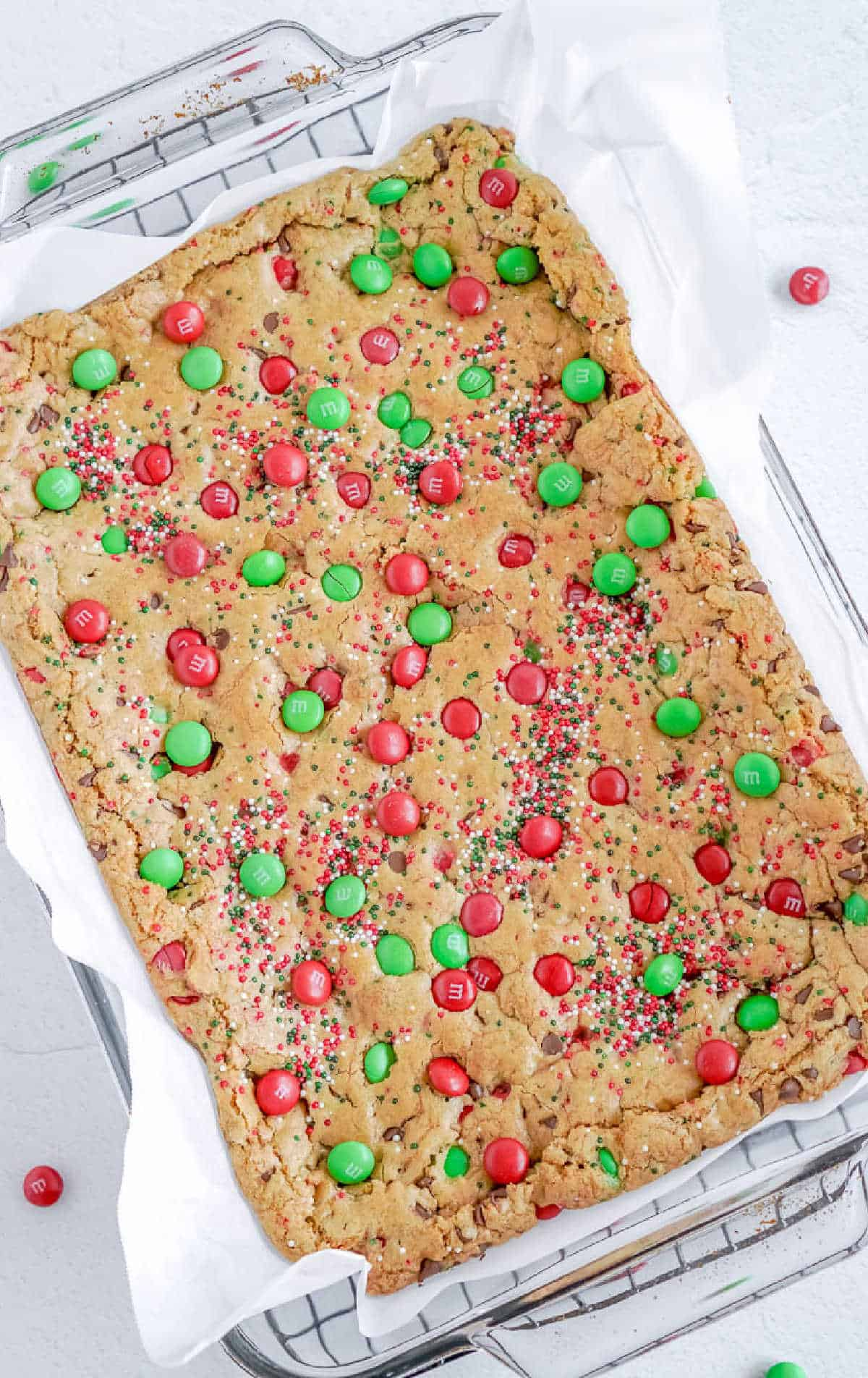 cookie bars on a baking sheet before being cut into squares.